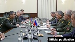 Russia - Defense Minister Sergey Shoygu (R) meets with his Azerbaijani counterpart Zakir Hasanov in Moscow, 15June2016.