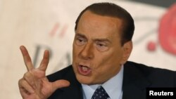Former Italian Prime Minister Silvio Berlusconi gestures as he talks during a friend's book launch in Rome in December 2012.