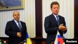 Киевта Газпром башлыгы Алексей Миллер (у) белән Украинаның эгергетика министры Юрий Продан (с)