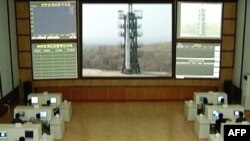 """TV grab showing a control room where a three-stage white rocket bearing the word """"Chosun"""" (Korea) appears at an unspecified launch site. (file photo)"""