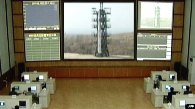 "TV grab showing a control room where a three-stage white rocket bearing the word ""Chosun"" (Korea) appears at an unspecified launch site. (file photo)"