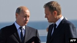 An end to calls for a boycott of Ukraine during Euro 2012 is one thing Polish Prime Minister Donald Tusk (right) and Russian President-elect Vladimir Purin can see eye to eye on.