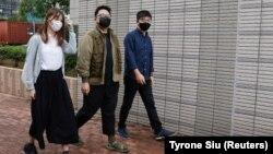 Aktivisti Ivan Lam, Džošua Vong and Agnes Čou dolaze u sud, 23. novembar