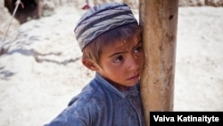 Khalid, 8, fled with his family from their home in Samangan Province.