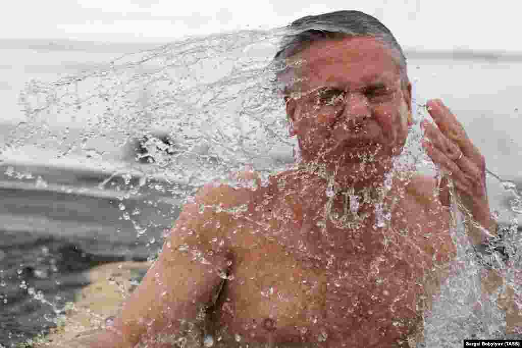U.S. Ambassador to Russia Jon Huntsman takes a dip as he marks Orthodox Epiphany at the New Jerusalem Monastery in the town of Istra outside Moscow on January 21. (TASS/Sergei Bobylev)