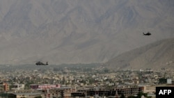 Afghanistan - US Army helicopters fly over Kabul, 02Jun2011