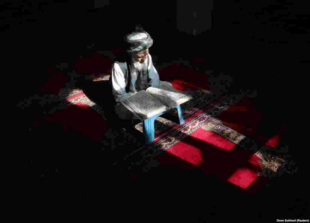 An Afghan man reads the Koran at a mosque in Kabul on May 4. (Reuters/Omar Sobhani)