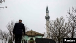 A Crimean Tatar arrives for Friday Prayers at the Khan Chair mosque in Bakhchysaray.