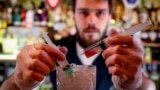 "A barman stirs the newly invented Coronavirus cocktail in a bar in Moscow on March 19. ""We have the situation under control,"" President Vladimir Putin has said."