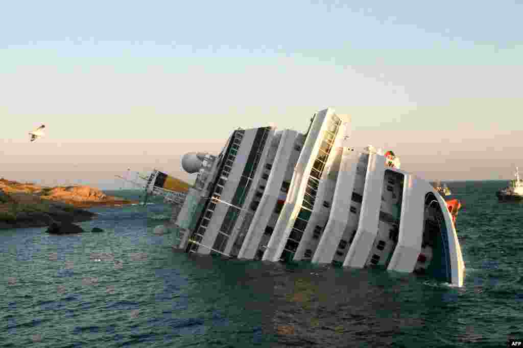 "The ""Costa Concordia"" cruise ship, which ran aground and keeled over with more than 4,000 people on board near the Italian island of Giglio on January 14. (AFP)"