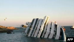 "The ""Costa Concordia"" after the cruise ship, with more than 4,000 people on board, ran aground and keeled over off the Tuscan coast."