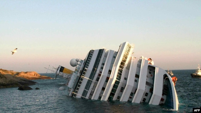 The Costa Concordia cruise ship lies partially submerged off the Italian island of Giglio.on January 16, 2012.