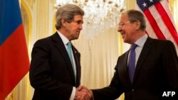 U.S. Secretary of State John Kerry (left) shakes hands with Russian Foreign Minister Sergei Lavrov in Paris in March 2014.