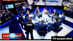 Eventually, the talk show's host called for support and two policemen entered the studio, flanking nationalist politician Volen Siderov.