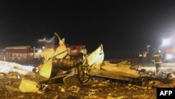Wreckage is seen at the site of a Tatarstan Airlines Boeing 737 crash at Kazan airport last month, which killed 50 people.