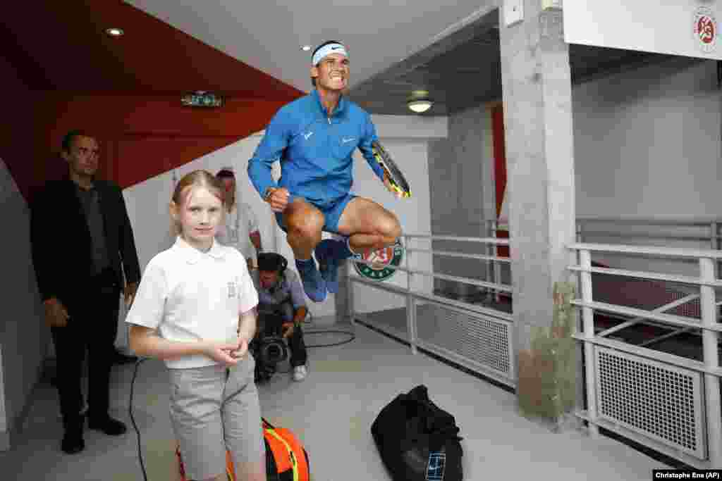 Spain's Rafael Nadal jumps in a corridor before his men's final match against Austria's Dominic Thiem at the French Open tennis tournament in Paris on June 10. (AP/Christophe Ena)