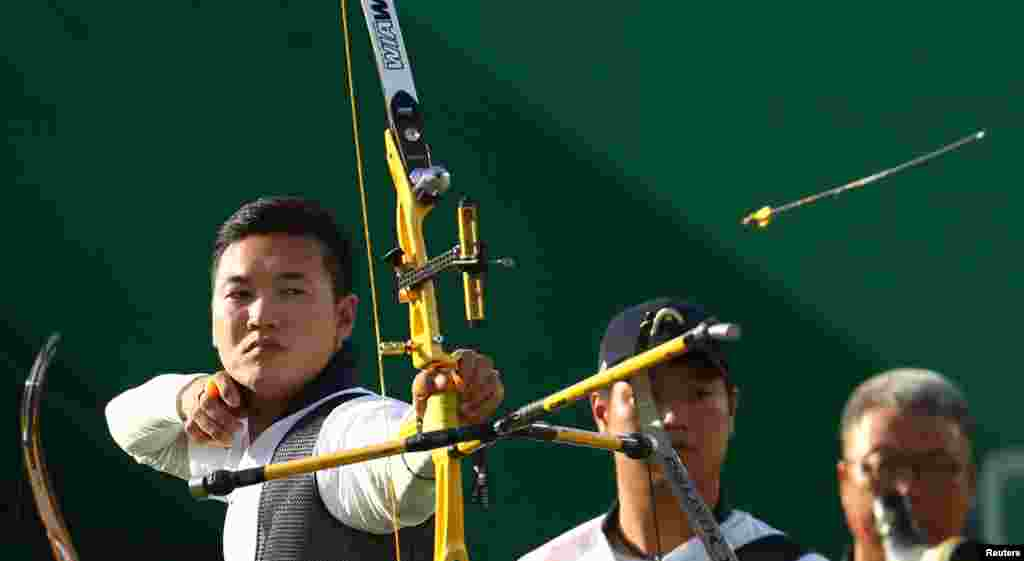 Members of the South Korean team compete in the men's archery semifinal. The Koreans eventually won gold in the men's team competition.