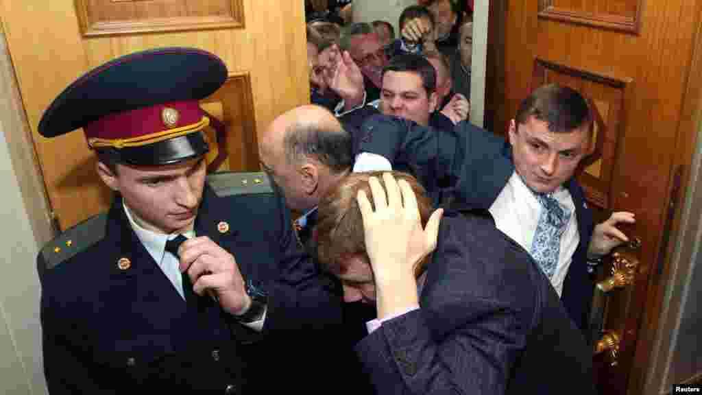 The fracas even spilled outside the chamber.