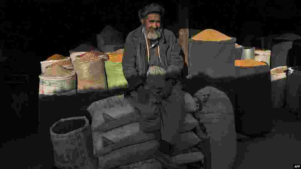 An elderly vendor sits at his shop in Kabul in April.
