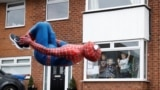 Jason Baird is seen dressed as Spiderman during his daily exercise to cheer up local children in Stockport, as the spread of the coronavirus disease (COVID-19) continues, Stockport, Britain, April 1, 2020. REUTERS/Phil Noble