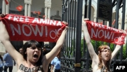 "Activists from the women's movement Femen demonstrate in Tunis on May 29. They shouted ""Free Amina,"" in reference to the young Tunisian woman imprisoned for protesting against hard-line Islamists and awaiting trial for illegally possessing pepper spray."