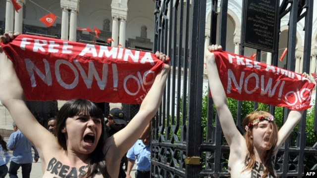 Activists from the women's movement Femen demonstrate in Tunis on May 29. They shouted 'Free Amina,' in reference to the young Tunisian woman imprisoned for protesting against hard-line Islamists and awaiting trial for illegally possessing pepper spray.