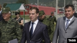 "Russian Defense Minister Anatoly Serdyukov (right) with President Dmitry Medvedev (center) during their visit to South Ossetia in July -- Russian officials also said Moscow will ""do everything to ensure the security of the Russian state, the security of t"