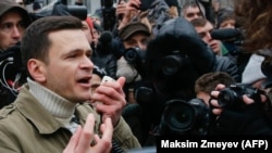 Russian opposition politician Ilya Yashin speaks during a banned rally in Moscow on December 24.