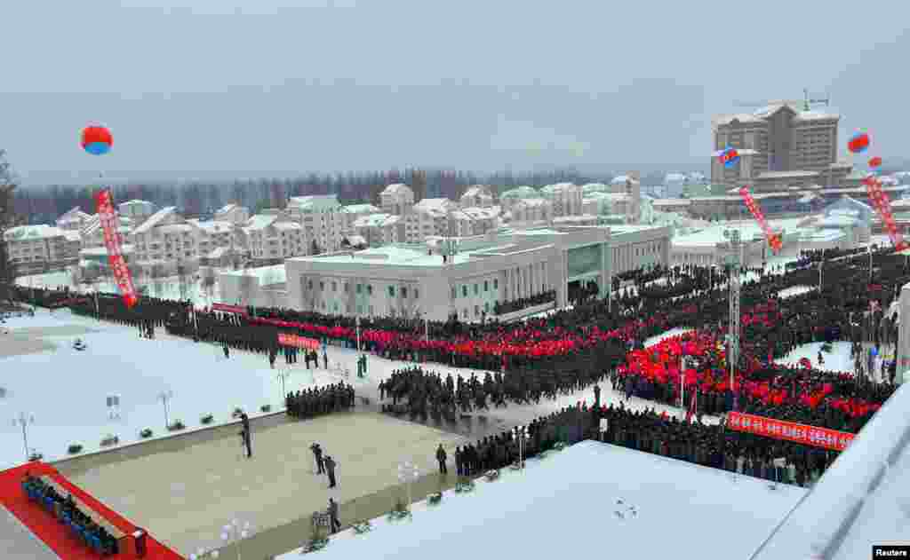 "A rooftop view of the regimented opening celebrations. State-run media described the city as ""an example of a mountainous modern city under socialism, an epitome of modern civilization."""