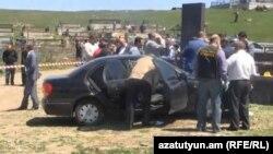 Armenia - Law-enforcement officers inspect a car in which a senior police officer, Koryun Harutiunian, was found dead, Hrazdan, 2May2013.