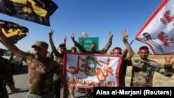 Shi'ite Popular Mobilization Forces (PMF) celebrate on the outskirts of Kirkuk, October 17, 2017