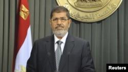 Եգիպտոս - Նախագահ Մուհամեդ Մուրսին հեռուստաուղերձով է հանդես գալիս նոր Սահմանադրության կապակցությամբ, Կահիրե, 26-ը դեկտեմբերի, 2012թ.
