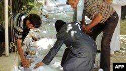 Погибшие при химической атаке в Сирии 21 августа 2013 года.