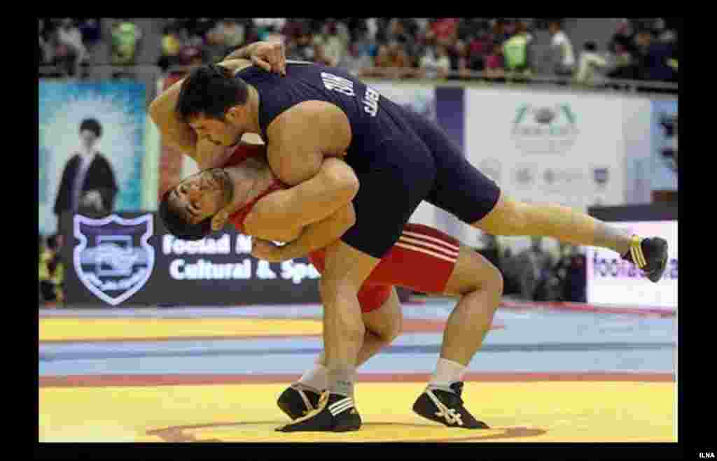 Competitors at the Wrestling World Cup in Tehran.
