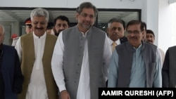 Pakistan's former petroleum minister and prime minister designate Shahid Khaqan Abbasi (C) leaves with his party leaders after a meeting at Parliament House in Islamabad on August 1.