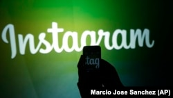 U.S. -- A journalist makes a video of the Instagram logo - generic