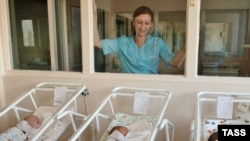 Precious youth: A nurse watches over newborns at a Moscow maternity hospital. (file photo)