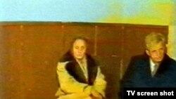 Николаэ и Елена Чаушеску во время суда. Декабрь 1989 года