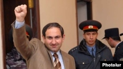 Nikol Pashinian gestures to supporters during his court appearance in March.