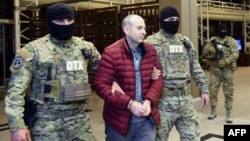 Azerbaijan -- Russian-Israeli blogger Aleksandr Lapshin is escorted upon his landing in Baku after being extradicted from Belarus to Azerbaijan, February 7, 2017