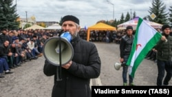 People gather to protest against what they say was an unfair land swap deal with the neighboring Russian region of Chechnya, in Ingushetia's capital, Magas.