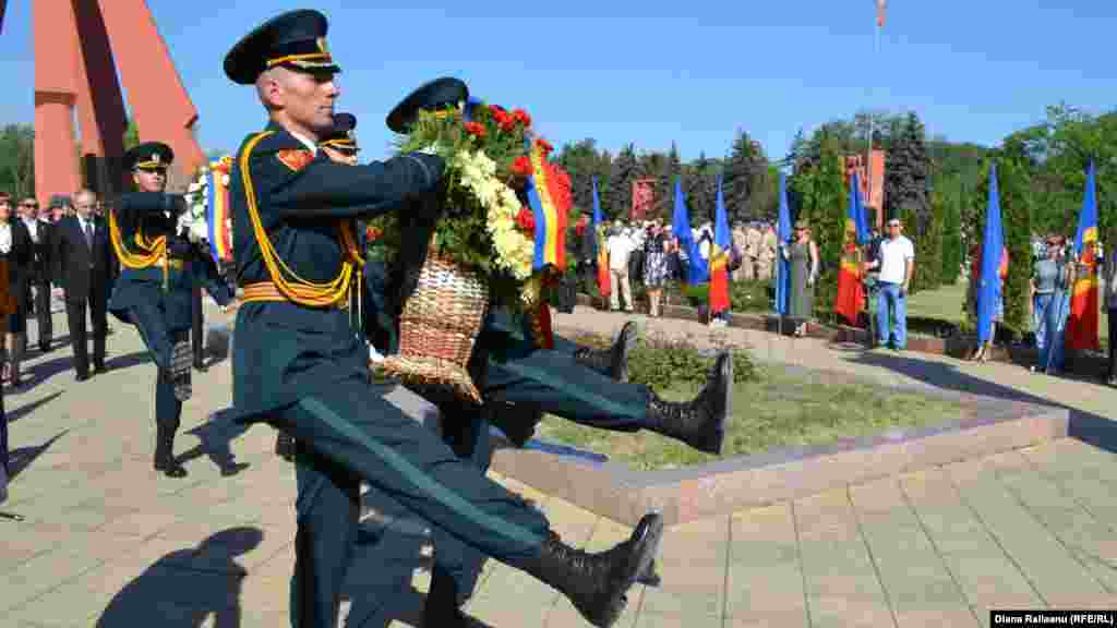 Soldiers take part in a Victory Day parade in the Moldovan capital, Chisinau.