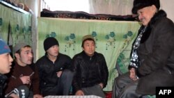 Kyrgyz ombudsman Tursunbek Akun (right) speaks with prisoners during a visit to a prison in Osh on January 20.