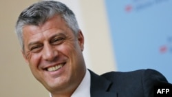 Kosovo Prime Minister Hashim Thaci smiles during a press conference by the International Steering Group for Kosovo in Vienna on July 2.