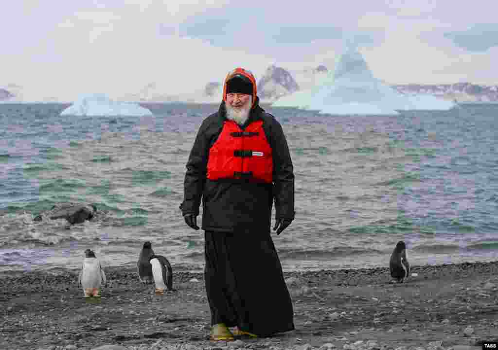 Russian Patriarch Kirill, wearing a life vest and surrounded by penguins, poses at Russia's Bellingshausen scientific station on the Island of Waterloo, Antarctica, on February 18. (TASS)