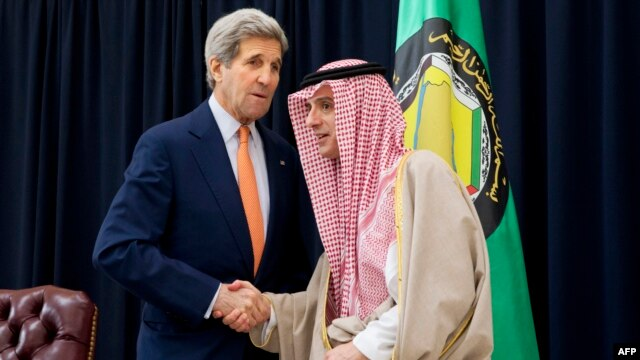 Saudi Foreign Minister Adel al-Jubeir (right) shakes hands with U.S. Secretary of State John Kerry on January 23.