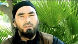 Screen grab of the Uzbek IS militant Abu Hussein al-Uzbeki on a video with the Furat Media logo.