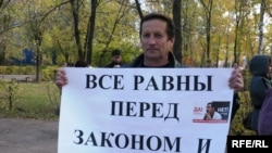A supporter of Yevgeny Zhovtis protests in October.