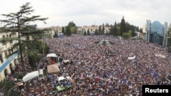 Thousands of people attend an election rally in support of the opposition bloc Georgian Dream in Zugdidi on September 22.