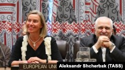 EU former foreign policy chief Federica Mogherini and Iranian Foreign Minister Mohammad Javad Zarif. FILE PHOTO